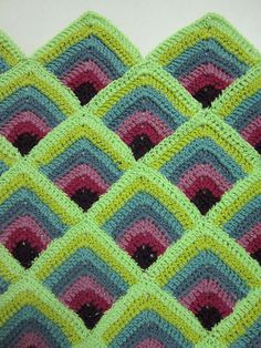 Blanket or afghan using a mitred square pattern via Flickr. It's all about colour choice!