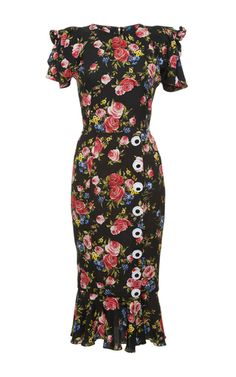 This **Dolce & Gabbana** dress features a placed floral print on stretch charmeuse with bow details at the shoulder and decorative button accents at the front.