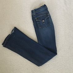 """Hudson Boot Cut Jeans Distressed Hudson Boot Cut jeans. So sexy and super flattering on the booty  slightly frayed on bottom of pants from walking. Length is 41"""" 27 waist. Don't fit anymore  still has plenty of life in them as they are well made jeans from our friends in the UK  Hudson Jeans Jeans Boot Cut"""