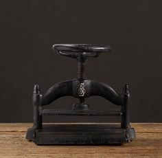 Restoration Hardware Cast Iron Book Press. I have a piece that has a similar look to this, bought at a flea market years ago.
