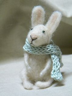 Needle felted bunny in a scarf.