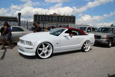 White Ford Mustang with red droptop
