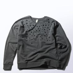 A casual sweatshirt goes glam. This girls' top sparkles with a scattering of rhinestones.