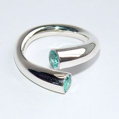 Stunning Topaz Wrap Silver Ring – beautiful design that can be worn several ways, have it so both stones are in the centre, or wear it so one is peeping round on one side. This ring is very comfortable to wear. By Paul Finch