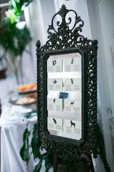 Snow White inspired wedding. Antique mirror seating chart. Woodland animals instead of table numbers for seating assignments. Photo by Stephiejoy.com