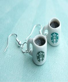 89956d2f950ca These earrings feature a pair of miniature Starbucks coffee mugs filled  with black coffee. The mug charms measure cm tall and are attached to a  silver tone ...