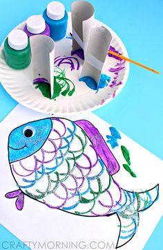 Make a fish craft using toilet paper rolls for making the scales! It's a fun ocean art project for kids to make with a free printable coloring page.
