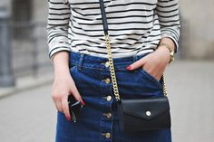 Close up on our 70s chic style denim skirt and striped roll neck top worn by Glitter Everywhere.