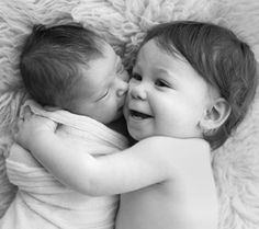 Adorable Pose for Sibling Photo with Baby