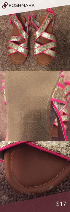 Pink sparkly justice sandals Adorable size 5 pink sandals in good condition however the right shoe has a small and not noticeable scuff on the front. Overall the shoes are really cute and comfortable. They Velcro in the back to you can adjust them. Justice Shoes Sandals