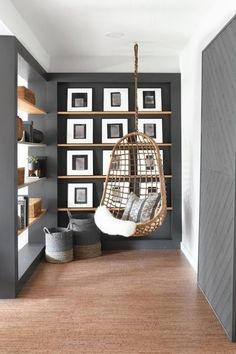 One Room Challenge Fall 2018 | Dorsey Designs nailed it in her basement makeover with this hanging chair, floating art shelves, and black built-in open bookshelf.