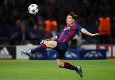 Lionel Messi of Barcelona stretches to control the ball during the UEFA Champions League Final between Juventus and FC Barcelona at Olympiastadion on June 6, 2015 in Berlin, Germany.