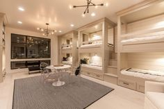 Contemporary Kids Bedroom with High ceiling, Built-in bookshelf, Bunk beds, Chandelier, Carpet, Wall sconce, Crown molding