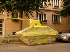 < IMAGE 4 OF 10 > Plastic Tank Bosso fakata via Laughing Squid Guerilla street artists Bosso fakata have been wrapping objects in Berlin with plastic as a political commentary about waste. Also about the dangers of leaving your car in public.