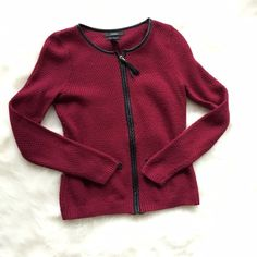 Brand New Tahari Sweater Never worn! Mint condition maroon Tahari sweater. Adorable faux leather detailing and tassle zipper. 15 inches across the chest and 21 inches long. 50% merino wool, 50% acrylic NO TRADES PLEASE Tahari Sweaters