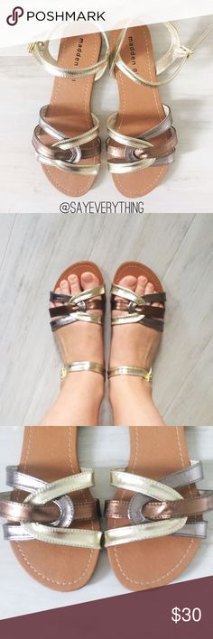 Madden Girl Flat Metallic Sandals Madden Girl by Steven Madden. Cute flat sandals with ankle straps and braided detailing over the toe box. Size 6.5. Gold, silver, and bronze metallic colors. Leather upper and manmade sole. Dress up your favorite summer outfit with these chic sandals! Excellent condition - they were a floor model, only worn inside for try ons. No box. Thanks for looking! Madden Girl Shoes Sandals