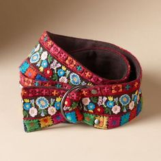 """Hand-worked needlepoint and embroidery create our striking belt, a pop of color and pattern to perk up anything. Double D-ring closure lets you cinch it where you will. Embroidery: rayon georgette. Lining: cotton. Hand wash. Imported. Exclusive. One size. 2-1/2""""W x Approx. 43""""L, length will vary."""