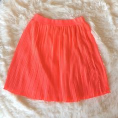 Circle Skirt Neon Pink Orange High Waisted Accordion Pleated Skirt. 19 inches long from band to seam. Stunning skirt, fully lined! Tiny flaw in in the folds (pictured). Can be worn at the hips or high waisted! Flowy fit. Waist 13 inches. Ya Los Angeles Skirts Circle & Skater