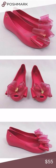 """Melissa Pink Ultragirl Sweet XII Bow Jelly Flats Good used condition with some scuffing and dirt throughout. Still completely wearable! Photos reflect condition.   Length Along Sole: 9.25""""  No trades, no modeling. Melissa Shoes Flats & Loafers"""