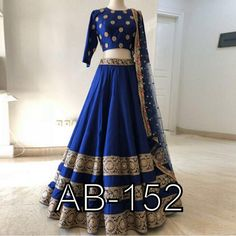 Give yourself an unique look by wearing this exquisite royal blue taffeta silk lehenga choli.This spectacular attire is highlighted interestingly heavy embroidery work that gives a divine look to the outfit. Paired with matching blouse and dupatta Lehenga Choli Designs, Ghagra Choli, Indian Bridal Outfits, Indian Fashion Dresses, Blue Fashion, Groom Fashion, Indian Lehenga, Silk Lehenga, Silk Dupatta