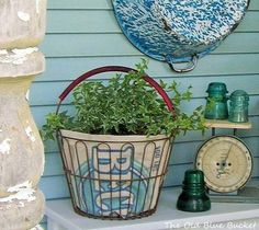 When choosing containers for my flowers I like to include a few repurposed vintage pieces along with my terra cotta pots & urns. Vintage Wire Baskets, Vintage Jars, Basket Planters, Flower Planters, Container Plants, Container Gardening, Wire Egg Basket, Primitive Garden Decor, Ivy Plants