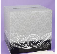This gray and black cardboard card box has a beautiful damask pattern and a white flourish design.