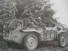 A reconnasince team operating with a VW Type 166 Schwimmwagen with an interesting storage bar used for extra grenades