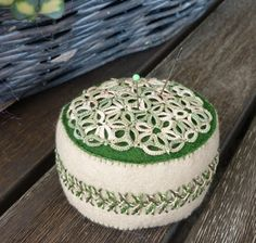 tatted flower of life on a pincushion w/ side embroidery