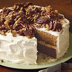 A gingery glazed nut topping and brown-butter-spiked cream cheese frosting are the finishing touches for this spectacular spiced pumpkin cake. Double the topping if you want to pile the nuts on as shown in the photo. For more side Thanksgiving dessert recipes visit The Guide to Thanksgiving Dinner.