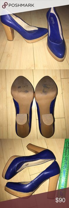Michael Kors size 9 patent leather blue pumps Michael Kors patent leather size 9m blue platform heels. Heel approx 4 1/2 in with a 1/2 in platform. Worn once. Beautiful Blue! Michael Kors Shoes Heels