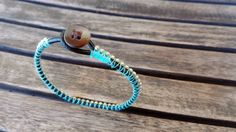 Minimal gold chain blue thread and leather bracelet