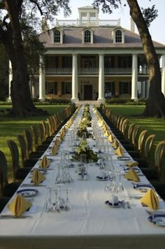 Absolute dream home and dream out door dining event. Big white antebellum style house with large white columns. Stunning.