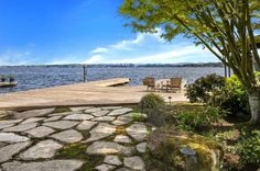 Natural stone pavers bring you from the garden to the dock with just a few steps.