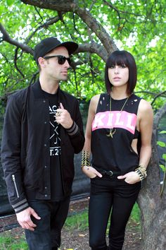 Lollapalooza '14 In 32 Gorgeous Street-Style Snaps #refinery29  http://www.refinery29.com/lollapalooza-street-style#slide10  Josh and Sarah of Phantogram looking fabulous. But, judging by her tank, you wouldn't want to get on her bad side.
