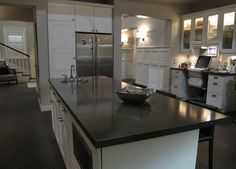 We love the juxtaposition of the black island countertop above the white cabinet! | Pretty Little Liars