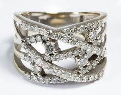 Lot 161: 14k White Gold and Diamond Ring; Having a cross-hatch design set with round cut diamond chips; marked 14k inside band