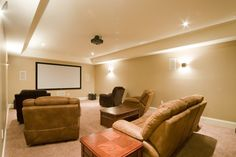 This dedicated Home Theatre Room is equipped with a projector and screen. The surround sound speakers are strategically placed to deliver optimum sound quality. Audio/video equipment is stored off to the side or even in a separate room to prevent any distraction from the screen.