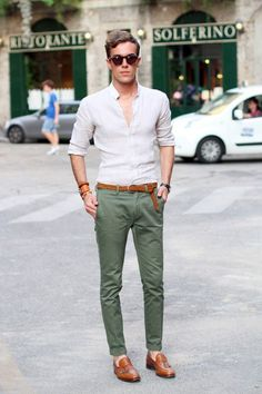 Shop this look on Lookastic: http://lookastic.com/men/looks/sunglasses-long-sleeve-shirt-belt-chinos-tassel-loafers/8064 — Dark Brown Sunglasses — White Long Sleeve Shirt — Tobacco Woven Leather Belt — Olive Chinos — Tobacco Leather Tassel Loafers