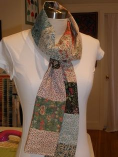 """charm square scarf by Fabric Crush. How to: 1 Charm Pack makes scarf approximately 5 X 96"""". Lay out your pieces in pleasing manner. Use 1/4"""" seam allowance to piece your charm pack two across, stacking them until you reach the end of the charm pack. Press. Pin. Sew along the long side, leaving the ends open. Turn right sides out and press again. Finish the ends by turning under 1/4"""". Top stitch the ends in a coordinating thread (this adds weight to the scarf and makes it lay flatter when…"""