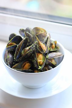 Curry Coconut Mussels Recipe -- The green curry is really flavorful, but I prefer the spice of red curry. I also like to throw in cilantro or basil. I might try the green curry again but add red pepper flakes for spice. Can't go wrong with mussels!