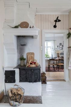 rustic kitchen with wood burning stove | by SHnordic
