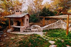 Amazing stone & timber holiday home in Greece with loads of charm, central conically shaped fireplace, stone tile floors and wood interiors by Philippitzis & associates Stone Tile Flooring, Magical Home, Stone Mountain, Earthship, Wood Interiors, Beautiful Interiors, Architecture Details, House Tours, Vacation