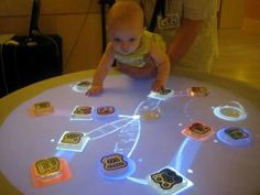 Reactable  Making music so tangible a baby can make it!