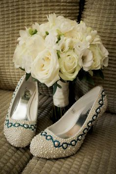Hand tied design including White Maroussia Rose, White Freesia & White eucalyptus