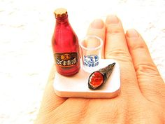 SouZouCreations makes a ton of different rings with miniature food items on them, they're strangely cute. lol