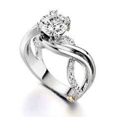 wedding rings-- I like the infinity sign with this one