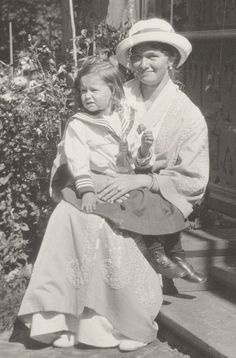 Grand Duchess Olga holding a little girl in sailor suit