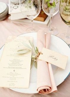 You don't need to go origami art with your napkins when it comes to folding. Sometimes a simple roll will do, as seen in this beautiful pink wedding place setting.