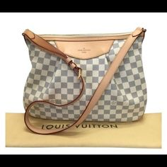 LV Siracusa MM Damier Azur Cross body LV Damier Azur MM - beautiful pre-loved condition ..leather in great condition..piping in excellent condition...inside is in great condition....comes with dust bag..very minimal signs of wear on this beauty... (one small scratch on front leather) price negotiable ...trades Louis Vuitton Bags Crossbody Bags
