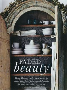 Photograph by Damian Russell from the April 2012 issue of House & Garden. century cupboard from Artefact, with tableware from Jme at Home.